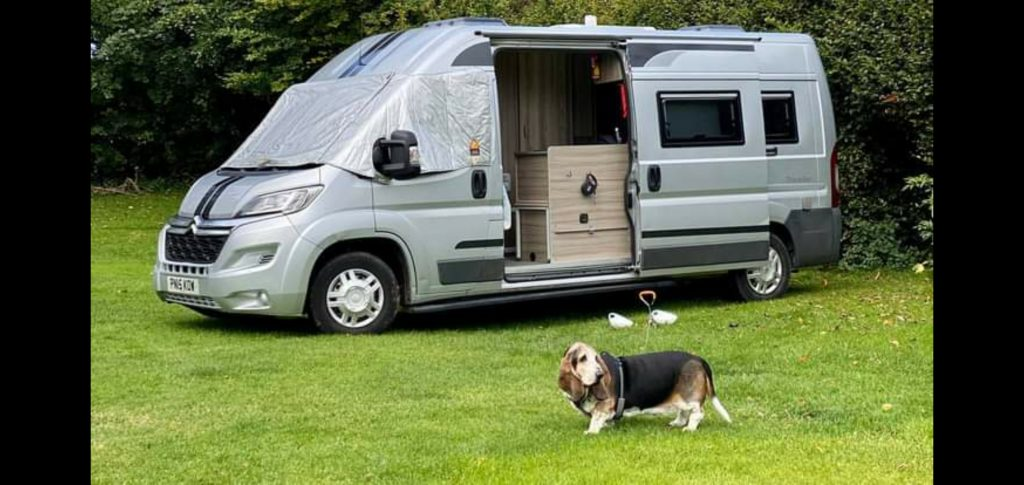 campervan in field with dog